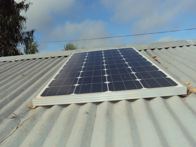 A solar panel on a house roof