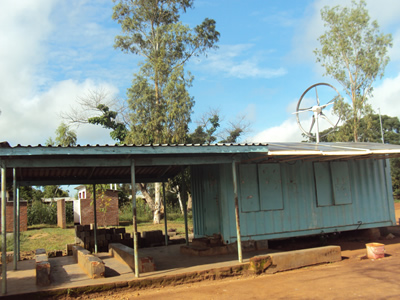 A combined solar and wind powered refurbished shipping container, now used as a clinic at Makata, Blantyre rural