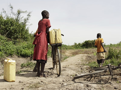 Women must bring water from long distances in Africa.