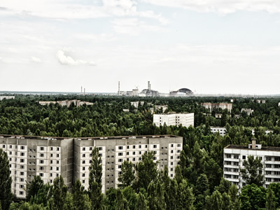 The ghost city Pripyat with Chernobyl on the horizon