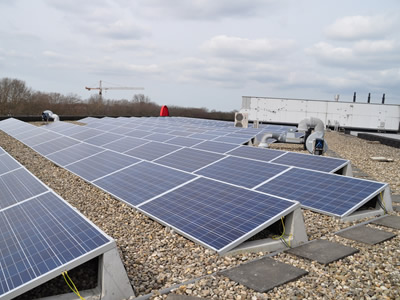 Solar panel installation with heavy concrete on the flat roof.