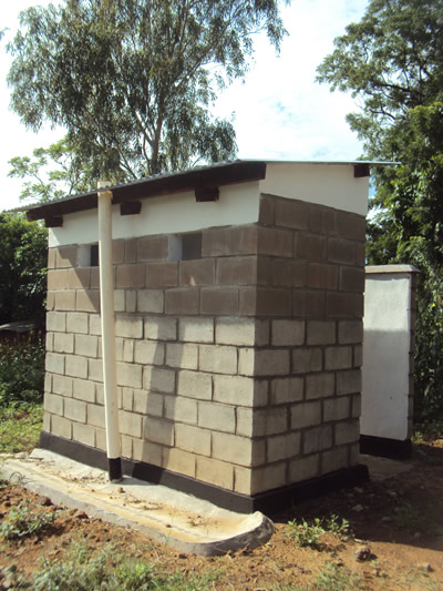 A pit latrine constructed using cement blocks.