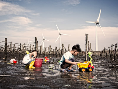 Children playing on the polluted land